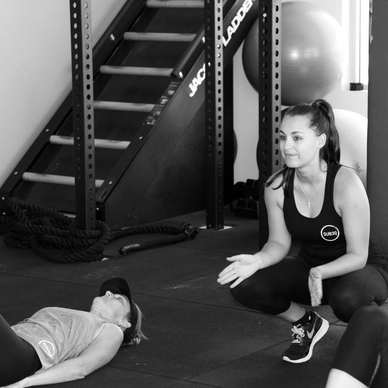 Sub30 Core Trainer Motivating client
